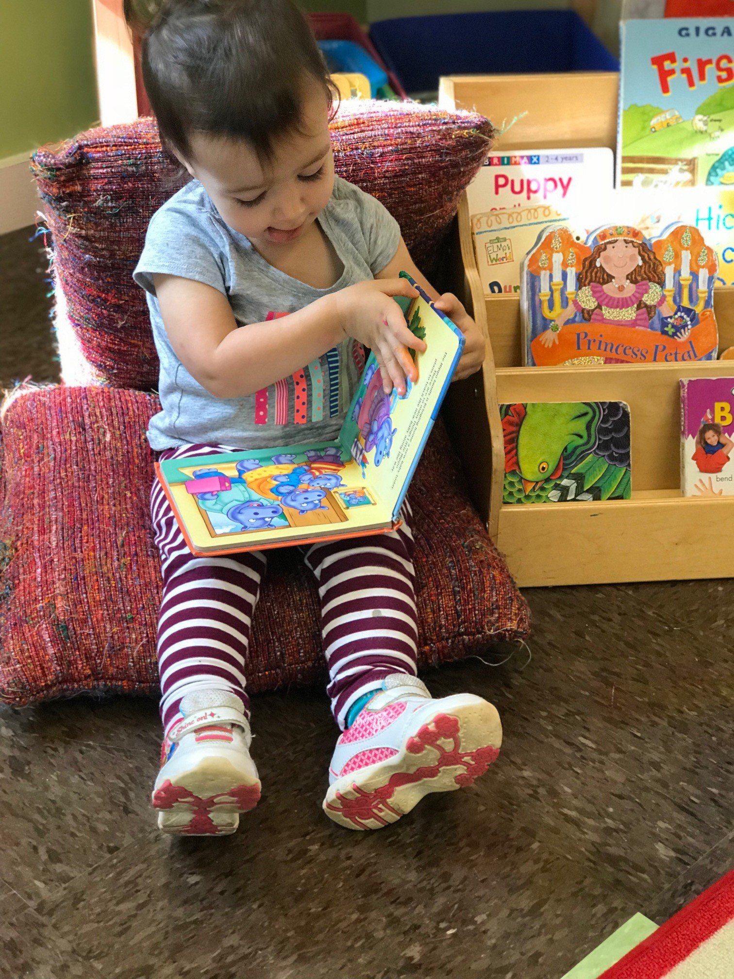 child looking at book